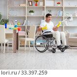 Купить «Disabled man cleaning floor at home», фото № 33397259, снято 7 апреля 2017 г. (c) Elnur / Фотобанк Лори