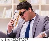 Купить «Businessman working on the floor at home», фото № 33397367, снято 10 февраля 2017 г. (c) Elnur / Фотобанк Лори