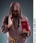 Купить «Monk in religious concept on gray background», фото № 33398071, снято 26 октября 2016 г. (c) Elnur / Фотобанк Лори