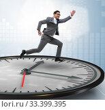 Купить «Businessman in time management concept», фото № 33399395, снято 1 апреля 2020 г. (c) Elnur / Фотобанк Лори
