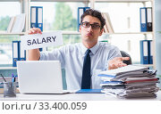 Young businessman asking for salary increase in office. Стоковое фото, фотограф Elnur / Фотобанк Лори