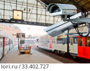 Купить «Security CCTV camera or surveillance system with railway station on blurry background», фото № 33402727, снято 25 марта 2020 г. (c) easy Fotostock / Фотобанк Лори