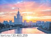 Высотка на рассвете High-rise building on Kotelnicheskaya embankment at dawn. Стоковое фото, фотограф Baturina Yuliya / Фотобанк Лори