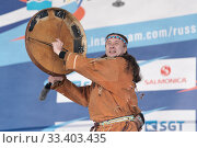 Купить «Male dancer in national clothes indigenous people emotional dancing with tambourine. Concert Koryak Dance Ensemble Mengo», фото № 33403435, снято 2 апреля 2019 г. (c) А. А. Пирагис / Фотобанк Лори