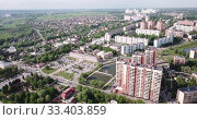 Купить «Aerial view of modern residential areas of Chekhov city in sunny spring day, Russia», видеоролик № 33403859, снято 13 мая 2019 г. (c) Яков Филимонов / Фотобанк Лори