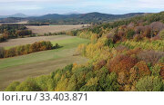 Купить «Picturesque view of country landscape with colorful trees on hillsides in autumn day», видеоролик № 33403871, снято 19 октября 2019 г. (c) Яков Филимонов / Фотобанк Лори