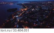 Купить «Night aerial view of modern Voronezh cityscape on banks of Voronezh river, Russia», видеоролик № 33404051, снято 27 мая 2019 г. (c) Яков Филимонов / Фотобанк Лори