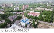 Купить «Aerial panoramic view of modern cityscape of Voskresensk overlooking Church of Icon of Mother of God of Jerusalem, Russia», видеоролик № 33404067, снято 12 мая 2019 г. (c) Яков Филимонов / Фотобанк Лори