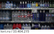 Купить «Shelves with bottled still and carbonated water in spanish store», видеоролик № 33404215, снято 17 февраля 2020 г. (c) Яков Филимонов / Фотобанк Лори