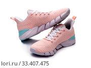 Купить «Летние женские розовые кроссовки на белом фоне», фото № 33407475, снято 9 марта 2020 г. (c) V.Ivantsov / Фотобанк Лори