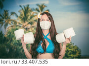 Купить «Frightened tourist woman in a medical mask presses with red suitcase, flights canceled», фото № 33407535, снято 18 марта 2020 г. (c) katalinks / Фотобанк Лори
