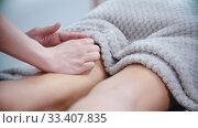 Купить «Massage - masseuse massaging the hips of a slender woman with a special massage technique», видеоролик № 33407835, снято 9 апреля 2020 г. (c) Константин Шишкин / Фотобанк Лори
