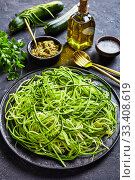 Купить «Zucchini spaghetti, zoodles on a black plate», фото № 33408619, снято 3 февраля 2020 г. (c) Oksana Zh / Фотобанк Лори