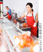 woman seller working at meat market. Стоковое фото, фотограф Яков Филимонов / Фотобанк Лори