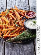 close-up of crispy salty Sweet Potato Fries. Стоковое фото, фотограф Oksana Zh / Фотобанк Лори