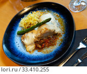 Купить «Cod fillet on ratatouille with chorizo, fries, rosemary aioli», фото № 33410255, снято 3 апреля 2020 г. (c) Яков Филимонов / Фотобанк Лори