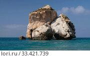 Купить «Aphrodite's Stone on Petra tou Romiou or Aphrodite Rock Beach, one of the main attractions and landmarks of Cyprus island.», видеоролик № 33421739, снято 17 марта 2020 г. (c) Serg Zastavkin / Фотобанк Лори