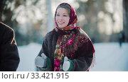 Russian folklore - beautiful russian woman in a scarf is clapping her hands. Стоковое фото, фотограф Константин Шишкин / Фотобанк Лори