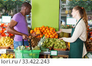 Купить «client is asking from seller female about freshness oranges», фото № 33422243, снято 26 мая 2018 г. (c) Яков Филимонов / Фотобанк Лори