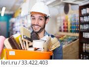 Купить «foreman holding basket with tools», фото № 33422403, снято 13 сентября 2017 г. (c) Яков Филимонов / Фотобанк Лори