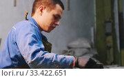 Concrete industry - man worker putting concrete in the cone form in the workshop. Стоковое видео, видеограф Константин Шишкин / Фотобанк Лори