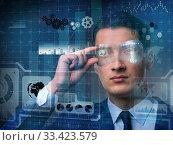 Купить «Futuristic vision concept with businessman», фото № 33423579, снято 6 июля 2020 г. (c) Elnur / Фотобанк Лори