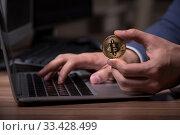 Купить «Male hacker hacking security firewall late in office», фото № 33428499, снято 15 мая 2019 г. (c) Elnur / Фотобанк Лори