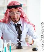 Купить «Arab chemist working in the lab office», фото № 33428615, снято 21 апреля 2018 г. (c) Elnur / Фотобанк Лори