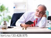 Купить «Old male accountant in budget planning concept», фото № 33428975, снято 12 сентября 2019 г. (c) Elnur / Фотобанк Лори