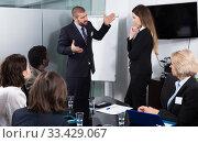 Businessman feeling angry to female coworker in office. Стоковое фото, фотограф Яков Филимонов / Фотобанк Лори