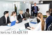 Купить «male discussing new business project with team», фото № 33429191, снято 10 марта 2018 г. (c) Яков Филимонов / Фотобанк Лори