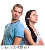 Купить «Portrait of young couple, man looking into camera, woman thinking smiling looking up», фото № 33429987, снято 16 февраля 2020 г. (c) Владимир Арсентьев / Фотобанк Лори