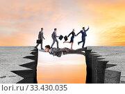 Купить «Businessman acting as a bridge in support concept», фото № 33430035, снято 6 июня 2020 г. (c) Elnur / Фотобанк Лори
