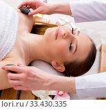 Купить «Young woman during spa procedure in salon», фото № 33430335, снято 26 февраля 2018 г. (c) Elnur / Фотобанк Лори