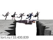Купить «Businessman acting as a bridge in support concept», фото № 33430839, снято 3 апреля 2020 г. (c) Elnur / Фотобанк Лори