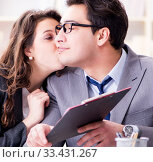 Happy couple working in the same office. Стоковое фото, фотограф Elnur / Фотобанк Лори