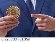 Купить «Businessman in bitcoin price increase concept», фото № 33431359, снято 29 марта 2020 г. (c) Elnur / Фотобанк Лори