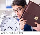 Купить «Businessman in rush trying to meet deadline», фото № 33431499, снято 2 декабря 2017 г. (c) Elnur / Фотобанк Лори