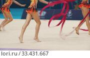 Купить «Young women giving a performance at the rhythmic gymnastics tournament using special ribbons», видеоролик № 33431667, снято 27 мая 2020 г. (c) Константин Шишкин / Фотобанк Лори