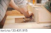 Купить «Carpentry working - hands of man worker polishing the plywood», видеоролик № 33431915, снято 2 июня 2020 г. (c) Константин Шишкин / Фотобанк Лори