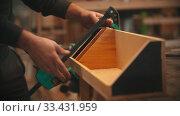 Купить «Carpentry working - hands of man worker making a wooden organizer», видеоролик № 33431959, снято 2 июня 2020 г. (c) Константин Шишкин / Фотобанк Лори