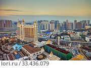 Купить «Aerial view of the Galaxy Macau Hotel, a luxurious resort complex, at dusk. Cotai, Macau, China.», фото № 33436079, снято 10 июля 2020 г. (c) age Fotostock / Фотобанк Лори