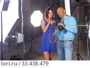 Купить «positive photographer and model discussing picture on camera display on city street», фото № 33438479, снято 5 октября 2018 г. (c) Яков Филимонов / Фотобанк Лори