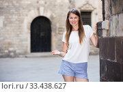 Young woman resting against old stone wall. Стоковое фото, фотограф Яков Филимонов / Фотобанк Лори