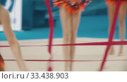 Купить «RUSSIA, KAZAN 12-03-2020, Kazan Stars Open: Young women giving a performance at the rhythmic gymnastics tournament using special ribbons», видеоролик № 33438903, снято 27 мая 2020 г. (c) Константин Шишкин / Фотобанк Лори