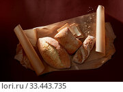 Купить «Bakery concept. Top view of bread and slices for sandwiches represented on cooking paper. Fresh bread after baking.», фото № 33443735, снято 30 мая 2020 г. (c) easy Fotostock / Фотобанк Лори