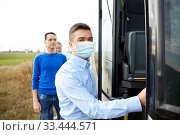 Купить «male passenger in medical mask boarding travel bus», фото № 33444571, снято 21 октября 2015 г. (c) Syda Productions / Фотобанк Лори