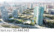 Купить «Aerial view of Barcelona cityscape with a modern apartment buildings, Spain», видеоролик № 33444943, снято 5 марта 2019 г. (c) Яков Филимонов / Фотобанк Лори