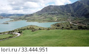 Купить «Panoramic view of Zahara lake in front of mountain range in Sierra de Grazalema Natural Park, Spain», видеоролик № 33444951, снято 18 апреля 2019 г. (c) Яков Филимонов / Фотобанк Лори