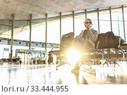 Купить «Woman stucked at airport terminal over flight cancellation,calling family, sitting in almost empty airport terminal due to coronavirus pandemic, Covid 19, outbreak travel restrictions», фото № 33444955, снято 10 января 2019 г. (c) Matej Kastelic / Фотобанк Лори